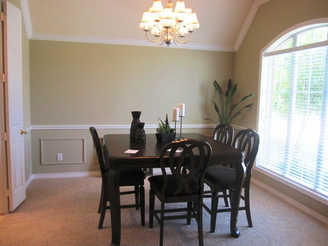 Dining room before staging by Home Star Staging