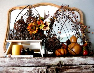 Year round I keep the top of this book case adorned with the mirror and the rustic iron planters. I simply change the decor as the season or mood strikes.